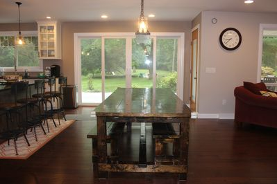 Solid wood, homemade dining room table - easily seats 10-12