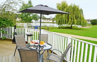 Photo for Stylish pet-friendly lakeside retreat in the Cotswold Water Park