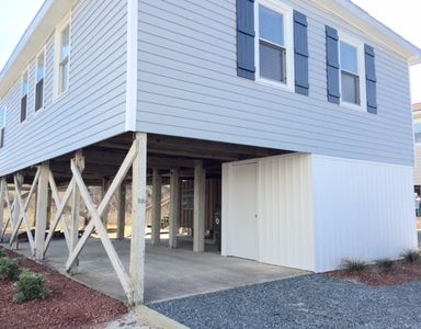 The house has a carport with long driveway and washer and dryer in storage area!