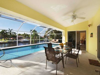 Photo for 31% OFF! - SWFL Rentals - Villa Amelia - Cozy Pool Home on Canal in SE Cape Coral Sleeps 6