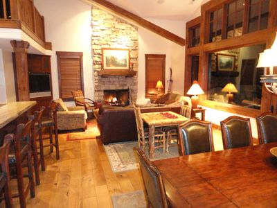 Great room with high vaulted ceiling, fireplace, and 20 mile views!