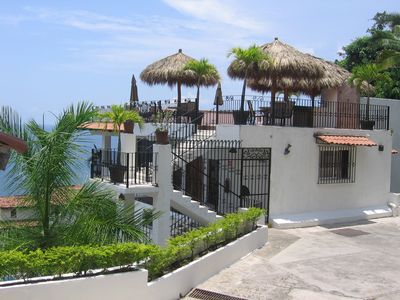 Private parking area with direct access to condo and rooftop patio/pool.