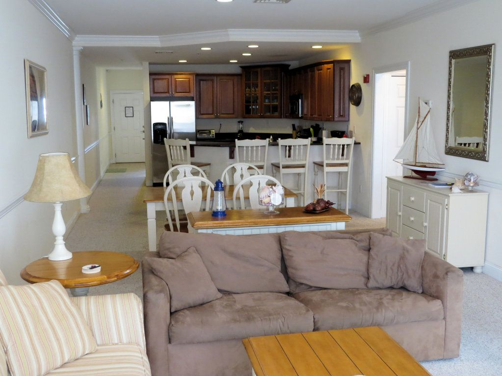 100 square feet room - Fire Placed Living Room Opens To Dining Area And Kitchen