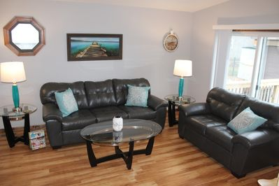 Great front room to relax.  Open concept with kitchen and dining area.