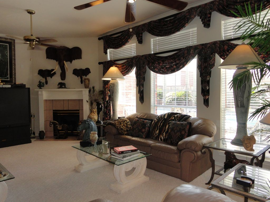 Whimsical Interior Design executive home tropical pool & spa whimsical - homeaway pearland