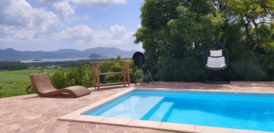 Photo for House with pool and garden and superb views of the Bay of Fort-de-France