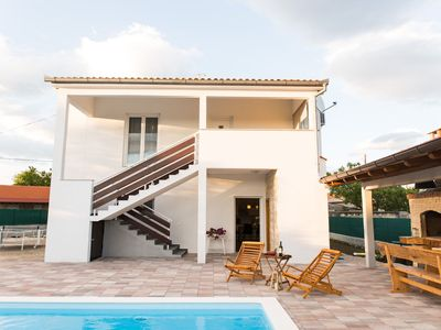 Photo for Lovely holiday home with private swimming pool, roofed terrace, outside kitchen