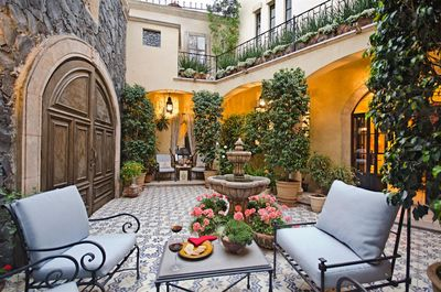 Your entry courtyard proves perfect for al fresco lunch or sunset cocktails!