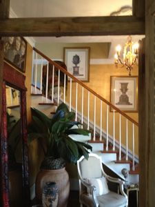 The dramatic foyer has a stair lift to the second floor.