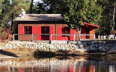 Photo for HOUSE SPRIT CABANE ON THE EDGE OF A POND IN THE HEART OF THE PYLA FOREST