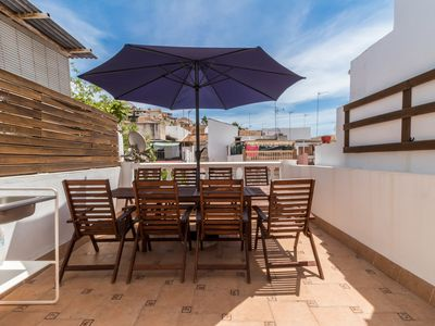 Photo for Townhouse with roof terrace near the beach