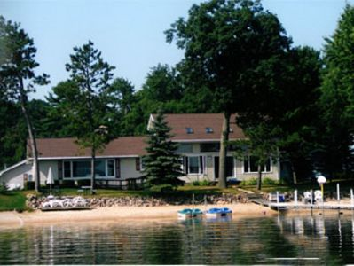 Photo for Spacious, 4-season lakefront home w/ over 100 ft of private sandy beach.