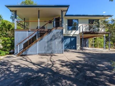 Photo for 12 Ibis Court - Highset beach house with natural bushland gardens and covered decks