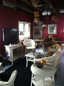 Living room/dining room  with some original antiques. Tv and CD player
