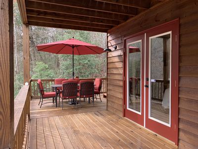 Photo for A relaxing upscale creekside cabin with hot tub, wifi and pool table.
