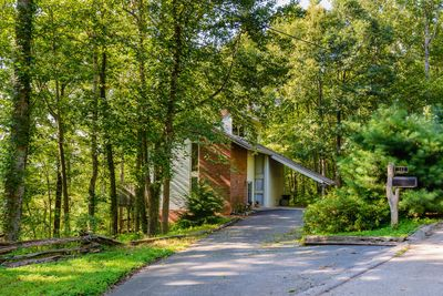 Private tri-level home in a wooded setting.