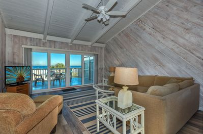 Upstairs, guests will find a spacious ocean view living room with vaulted ceilings