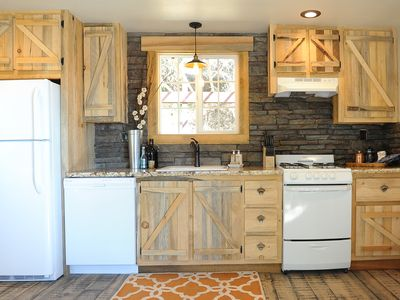 Photo for HANDCRAFTED RUSTIC RETREAT! DOWNTOWN COTTAGE