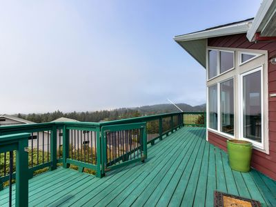 Photo for NEW LISTING! Hillside home w/ deck & wonderful ocean view of Haystack Rock!