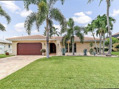 Photo for Palm tree Paradise! Private canal front home just minutes to the river!
