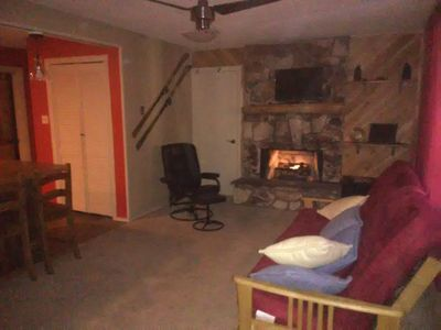living room, with a great, cozy gas fireplace and heated vibrating chair.