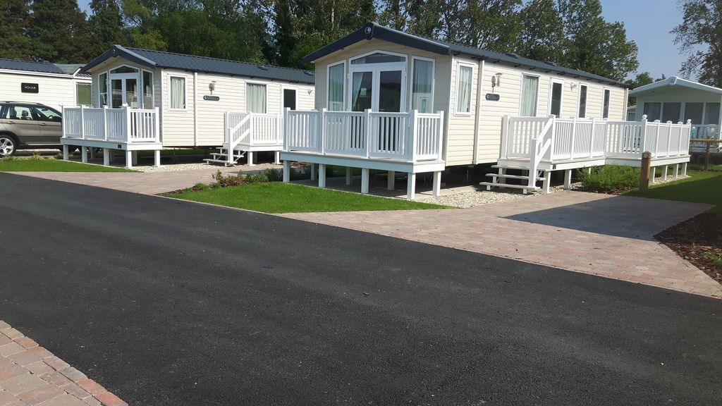 mobile home prestige avec decking sur un parc de vacances 5 haven poole abritel. Black Bedroom Furniture Sets. Home Design Ideas