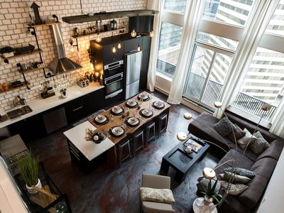 Photo for Fireworks Artist Penthouse near Roger's Place, with breakfast, wine, parking/LRT