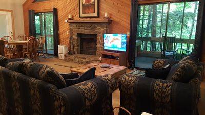 Photo for Charming Woodlands Cabin has 2 bedrooms, 2 bath, hot tub, wifi, peaceful setting.