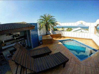 Photo for Beautiful top floor overlooking the sea! Á just 50m from the Beach Cove.