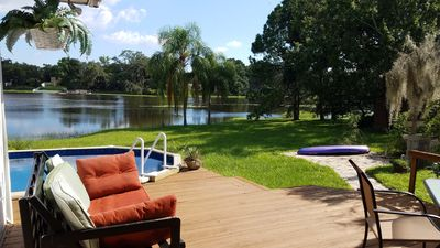 Photo for Charming, lakefront cottage-like home with pool