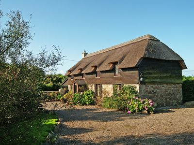 Photo for Traditional thatched cottage, with old world charm, on quiet country road about 7 minutes walk…