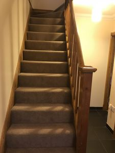 Carpeted stairs leading to First Floor.