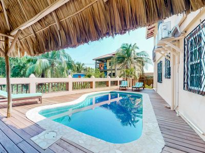 Photo for Gorgeous condo w/ easy beach access & pool in Belize!