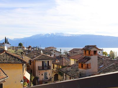 Photo for Luxury penthouse and design with stunning views of Lake Garda