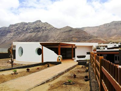 Photo for Detached villa, right on the beach of Famara in the north of Lanzarote
