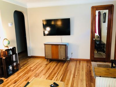 "First Floor - Living Room features 50"" HDTV with DirecTV Now, Netflix & Amazon"