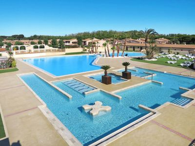 Photo for 3 bedroom Villa, sleeps 7 with Pool and Walk to Beach & Shops