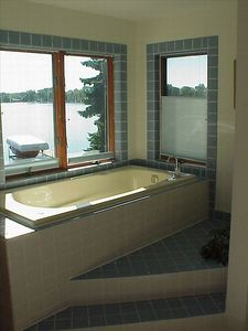 A heated whirlpool overlooking the water!