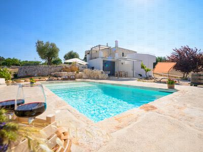 Photo for Charming trulli with panoramic pool