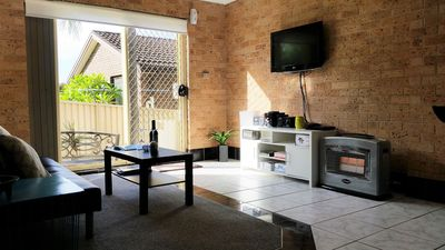 Large living room with comfy couch, gas heating, HD TV, Nintendo Wii, Foxtel IQ3