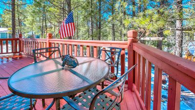 Sunny front deck surrounded by trees and birds. Covered patio on rear deck.