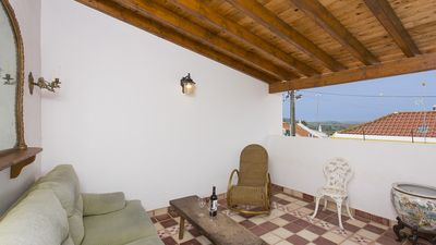 Upstairs terrace with comfy sofa and rocking chair,  with country views