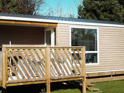 Photo for Comfortable mobile home with wood porch in Port-en-Bessin