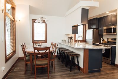 Dining room with table & chairs for 6;  4 bar stools for counter seating.