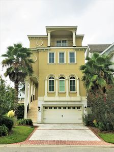 Welcome to 114 Sandcastle the largest and most custom home in Sandcastle by the