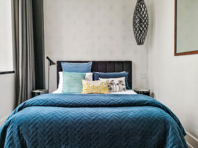 Super comfortable bed with luxurious linen and designer furnishings.