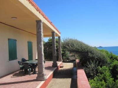 Photo for Panoramic sea front housewith garden and beach directly below