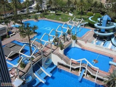 Photo for Benalbeach7 Renovated. Sea views. Huge pools and slides. By the beach