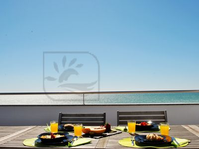 Photo for SUPERB BRAND NEW APARTMENT, ON THE SEA FRONT, WI-FI, AIR CON, NEAR ALL AMENITIES