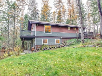 Photo for Waterfront home with cozy wood stove, deck, and private pond!